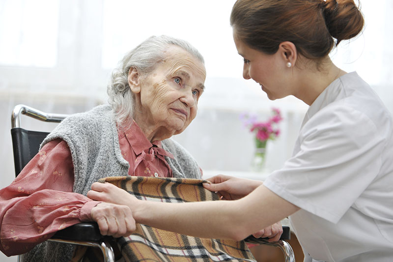 Female nurse is taking care of the senior woman